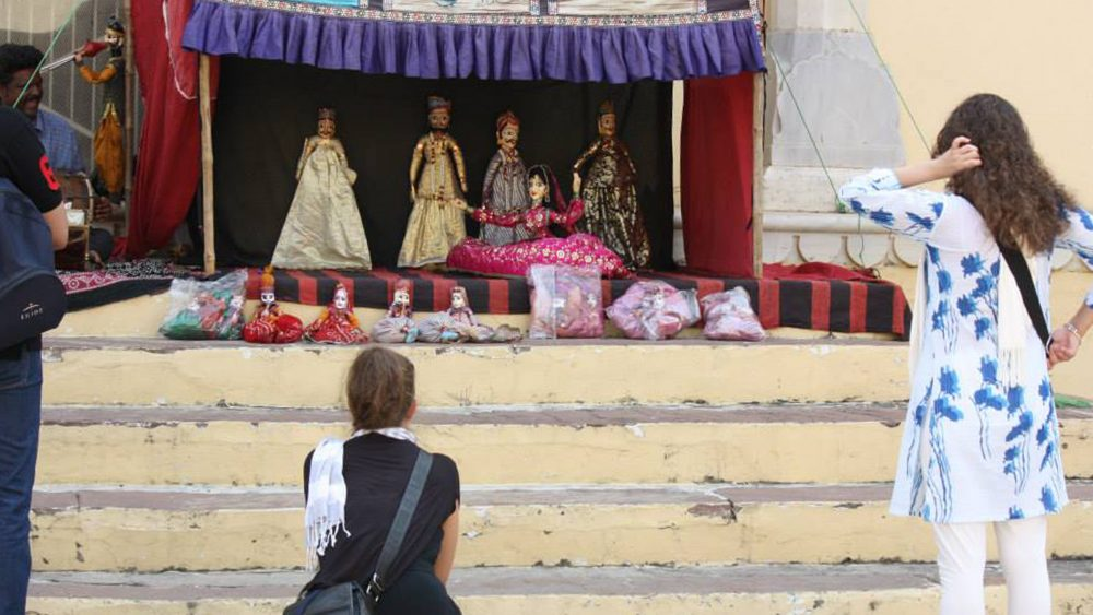 Dana and Tammy watch a traditional Rajasthani puppet show
