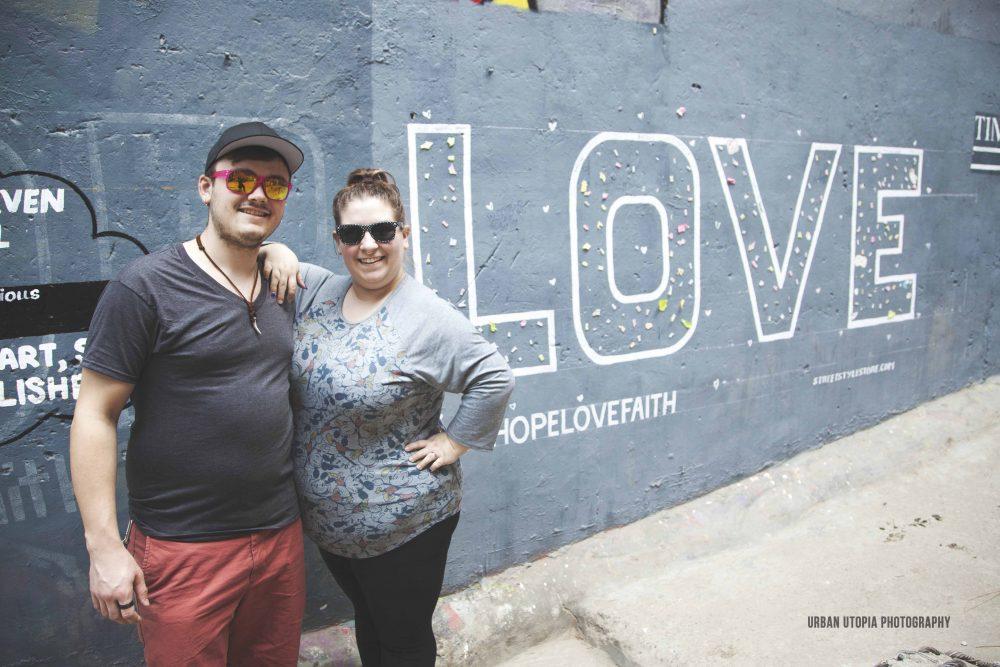 Courtney and Daniel take advantage of local street art in Hauz Khas